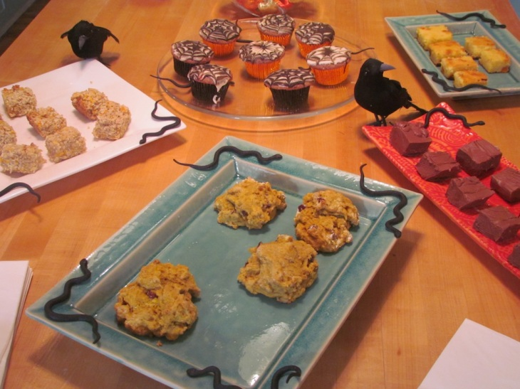 Trunk show treats - Yes, I made them.  From 11 o'clock going clockwise, Pumpkin granola bars, Spider Web Cupcakes, Pumpkin Blondies, Delicious, decadent fudge and Pumpkin Scones